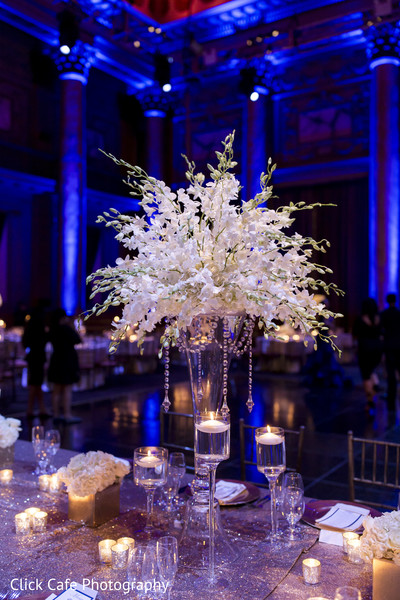 Delicate white table centerpiece. in Jersey City, NJ Indian Wedding by Click Café Photography