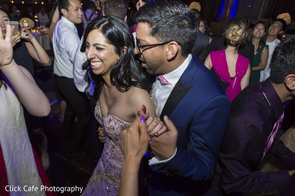 Getting the party started in indian wedding reception in Jersey City, NJ Indian Wedding by Click Café Photography
