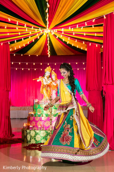 Lovely maharani during Garba in Tampa, FL Indian Wedding by Kimberly Photography