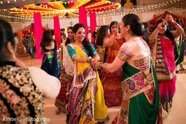 Family having fun during Garba in Tampa, FL Indian Wedding by Kimberly Photography