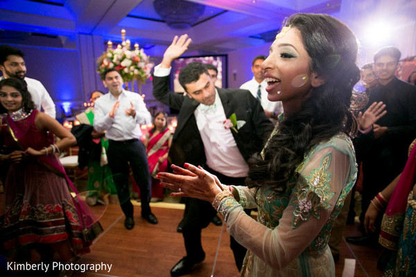 Getting the party started in indian wedding reception in Tampa, FL Indian Wedding by Kimberly Photography