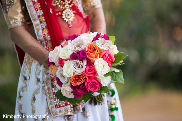 Lovely maharani with her flower bouquet in Tampa, FL Indian Wedding by Kimberly Photography