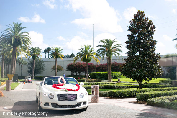 White car with flower arrangements for Indian couple in Tampa, FL Indian Wedding by Kimberly Photography