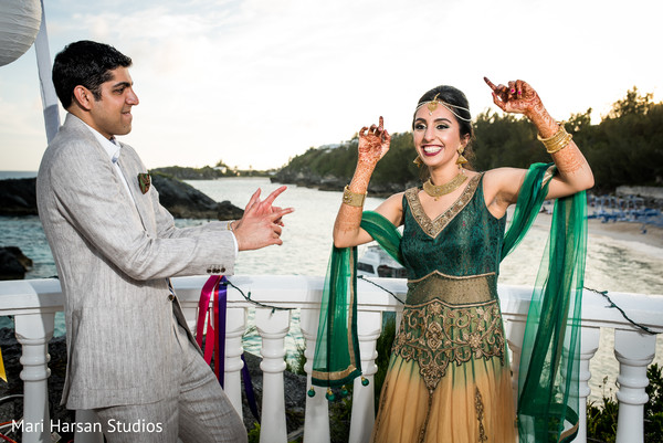 Indian bride and groom dancing. in Southhampton, Bermuda Indian Wedding by Mari Harsan Studios