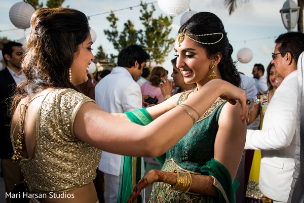 Indian bride welcomes the guests to pre -wedding beach party. in Southhampton, Bermuda Indian Wedding by Mari Harsan Studios