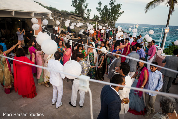 Indian pre-wedding beach party. in Southhampton, Bermuda Indian Wedding by Mari Harsan Studios