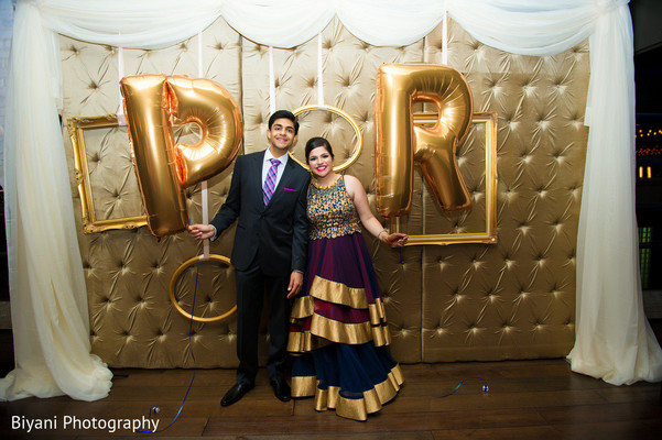 bride and groom reception portrait,blue lengha,gold lengha,purple lengha