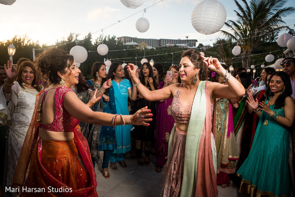 Family enjoys of the pre-wedding beach party. in Southhampton, Bermuda Indian Wedding by Mari Harsan Studios