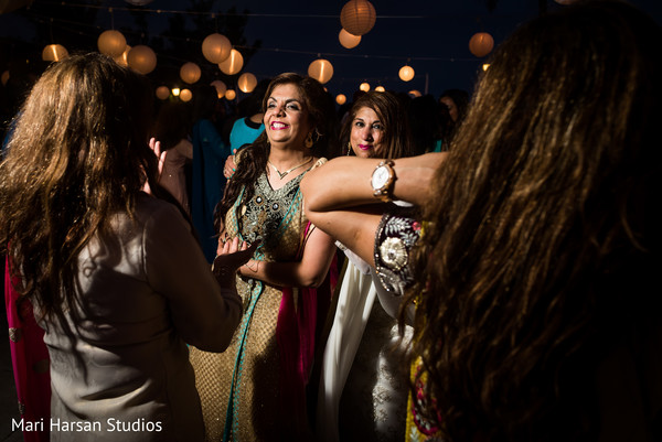 Guests dancing during pre-wedding seaside party. in Southhampton, Bermuda Indian Wedding by Mari Harsan Studios