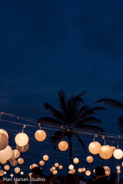Beautiful paper lamps lightning the seaside party . in Southhampton, Bermuda Indian Wedding by Mari Harsan Studios