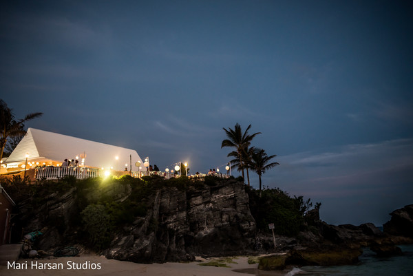Lovely view of indian beach pre-wedding celebration. in Southhampton, Bermuda Indian Wedding by Mari Harsan Studios