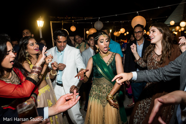 Bride enjoying the seaside pre-wedding party. in Southhampton, Bermuda Indian Wedding by Mari Harsan Studios