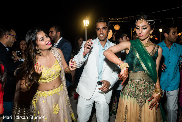 Indian Bride enjoying with her guests at the seaside pre-wedding party. in Southhampton, Bermuda Indian Wedding by Mari Harsan Studios