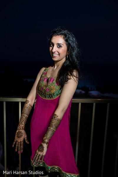 Lovely indian bride showing her intricate mehndi. in Southhampton, Bermuda Indian Wedding by Mari Harsan Studios