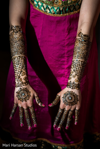 Perfect match between fuchsia nails and a beautiful mehndi design. in Southhampton, Bermuda Indian Wedding by Mari Harsan Studios