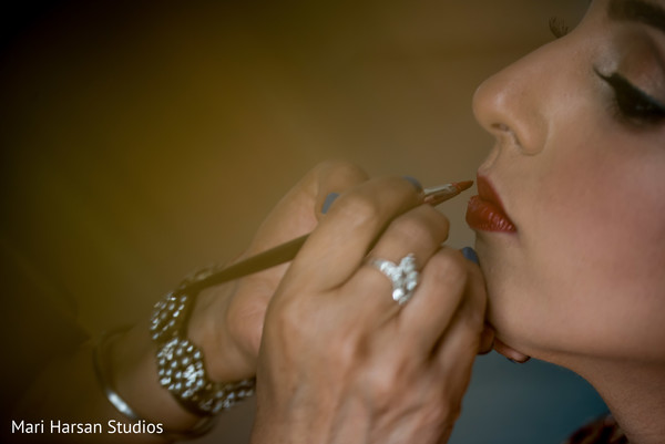 Indian bride getting her make up done. in Southhampton, Bermuda Indian Wedding by Mari Harsan Studios