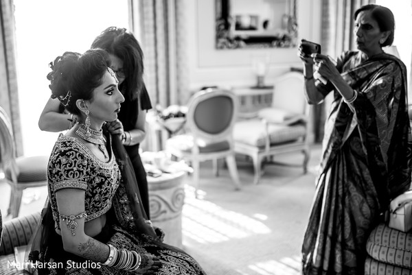 Indian bride getting ready for ceremony. in Southhampton, Bermuda Indian Wedding by Mari Harsan Studios
