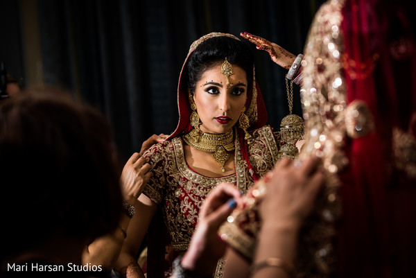 See this indian bride looking as a goddess for her ceremony. in Southhampton, Bermuda Indian Wedding by Mari Harsan Studios