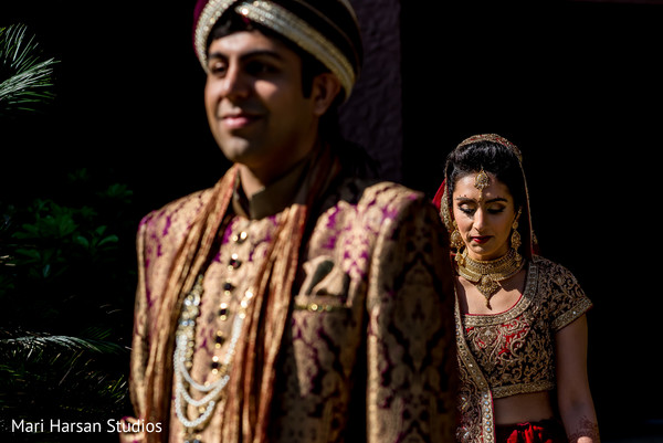Indian bride just a second before she surprise her raja. in Southhampton, Bermuda Indian Wedding by Mari Harsan Studios