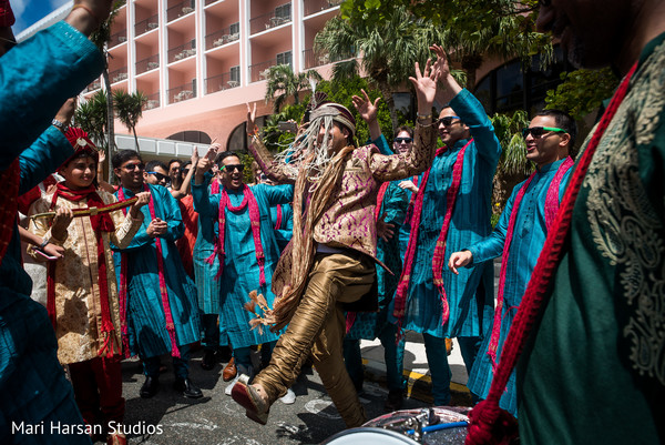 Indian groom dancing in baraat procession. in Southhampton, Bermuda Indian Wedding by Mari Harsan Studios