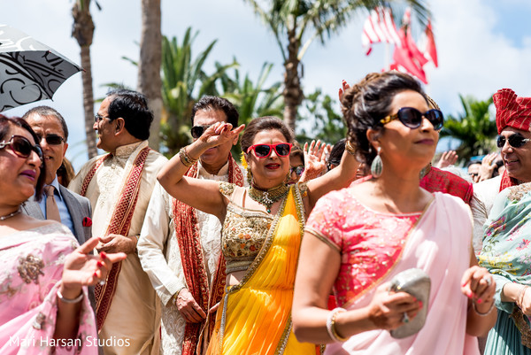 Relatives escorting the indian groom during baraat celebration. in Southhampton, Bermuda Indian Wedding by Mari Harsan Studios