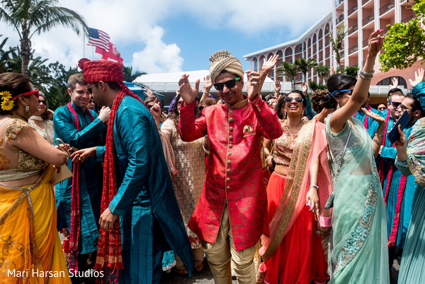 Groom's family and friends dancing during the baraat procession. in Southhampton, Bermuda Indian Wedding by Mari Harsan Studios