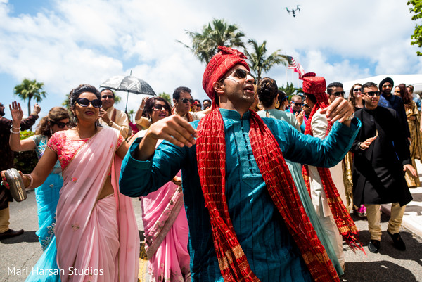 Dancing family and friends during the baraat procession. in Southhampton, Bermuda Indian Wedding by Mari Harsan Studios