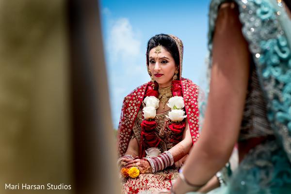 Indian bride wearing her rose garland. in Southhampton, Bermuda Indian Wedding by Mari Harsan Studios