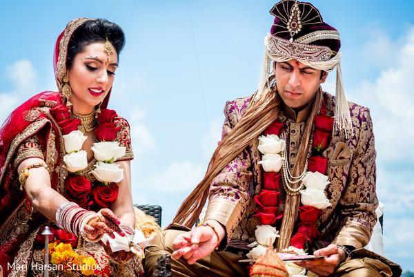 Indian wedding ceremony ritual. in Southhampton, Bermuda Indian Wedding by Mari Harsan Studios
