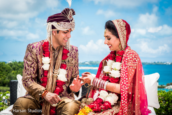 Indian bride and groom exchanging rings. in Southhampton, Bermuda Indian Wedding by Mari Harsan Studios