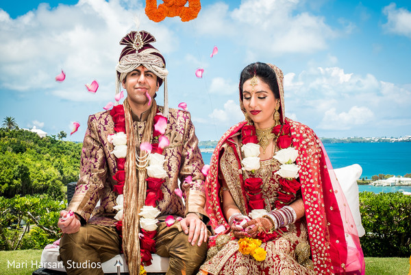 Amazing wedding ceremony next to the sea. in Southhampton, Bermuda Indian Wedding by Mari Harsan Studios