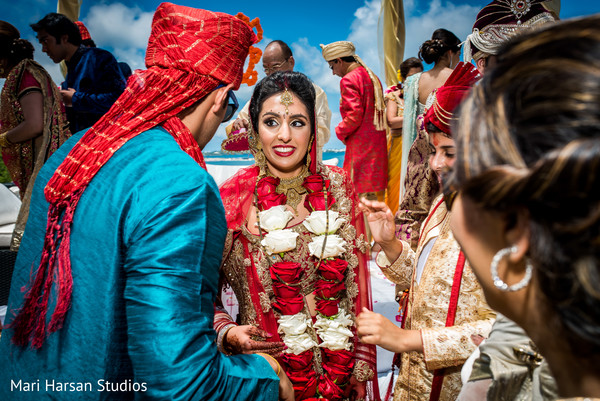 Bride congratulated by family and friends after ceremony. in Southhampton, Bermuda Indian Wedding by Mari Harsan Studios