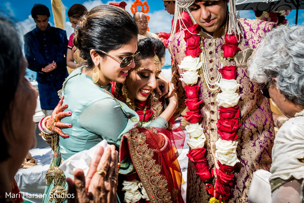 Indian bride and groom congratulated by family and friends. in Southhampton, Bermuda Indian Wedding by Mari Harsan Studios