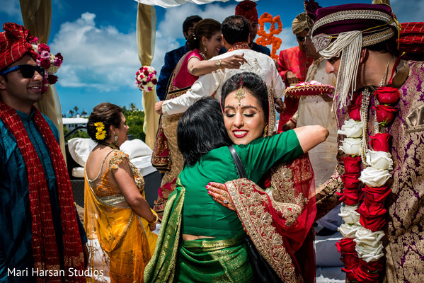 Indian bride moments after wedding ceremony is over. in Southhampton, Bermuda Indian Wedding by Mari Harsan Studios