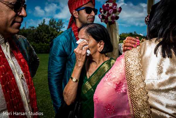 Emotional moments after wedding ceremony. in Southhampton, Bermuda Indian Wedding by Mari Harsan Studios