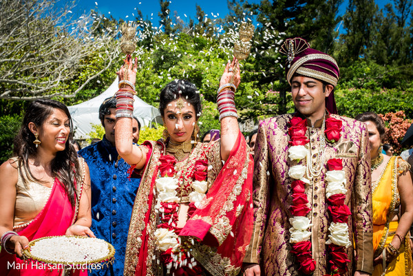 Indian bride showered in rice. in Southhampton, Bermuda Indian Wedding by Mari Harsan Studios