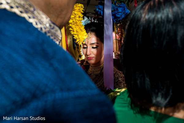 Indian bride ready to leave the wedding ceremony. in Southhampton, Bermuda Indian Wedding by Mari Harsan Studios