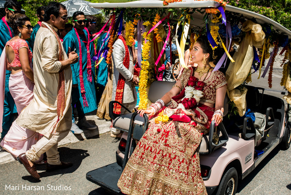 Indian bride transported in a decorated golf car. in Southhampton, Bermuda Indian Wedding by Mari Harsan Studios