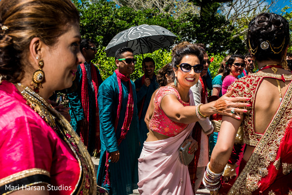 Family and friends saying goodbye to the indian newlyweds. in Southhampton, Bermuda Indian Wedding by Mari Harsan Studios