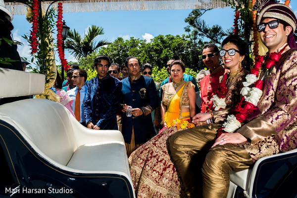 Indian wedding couple having fun after wedding ceremony. in Southhampton, Bermuda Indian Wedding by Mari Harsan Studios