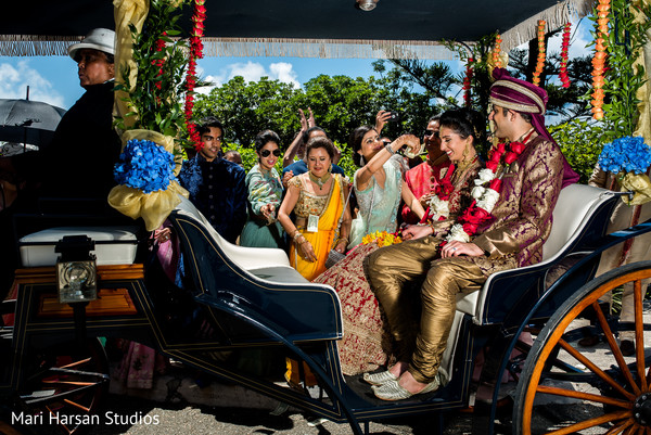 Elegant carriage transporting the indian bride and groom after the ceremony. in Southhampton, Bermuda Indian Wedding by Mari Harsan Studios