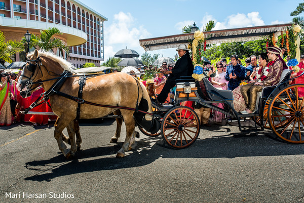 Elegant carriage transporting the bride and groom after the ceremony. in Southhampton, Bermuda Indian Wedding by Mari Harsan Studios