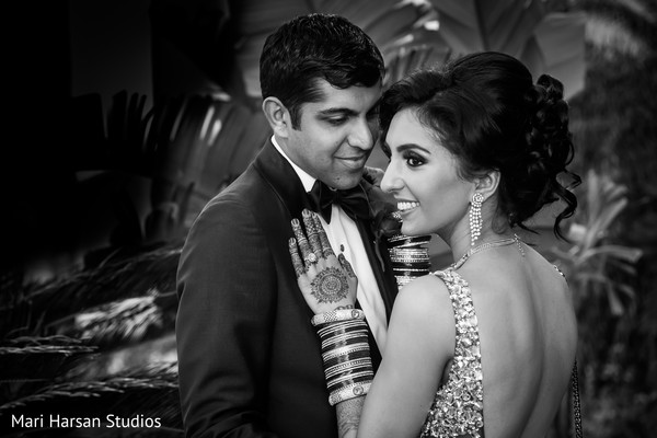 Elegant black and white portrait of indian newlyweds before the reception. in Southhampton, Bermuda Indian Wedding by Mari Harsan Studios