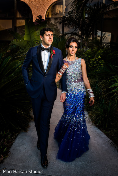 Glamorous indian bride and groom in blue reception outfits. in Southhampton, Bermuda Indian Wedding by Mari Harsan Studios