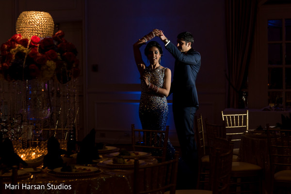 Indian bride and groom dancing in the dark. in Southhampton, Bermuda Indian Wedding by Mari Harsan Studios