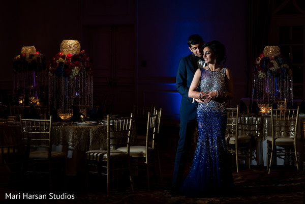Indian bride and groom dancing in the middle of the ballroom. in Southhampton, Bermuda Indian Wedding by Mari Harsan Studios