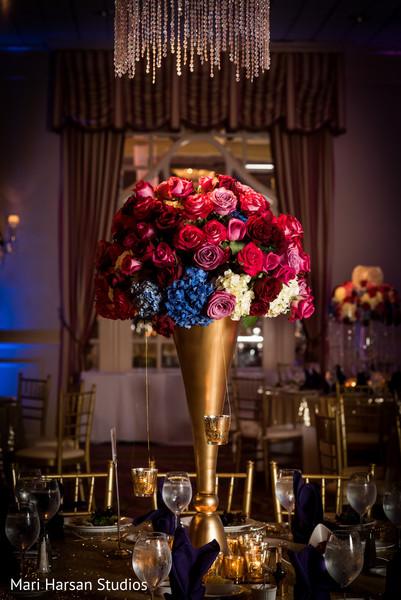 Beautiful floral wedding reception centerpiece. in Southhampton, Bermuda Indian Wedding by Mari Harsan Studios