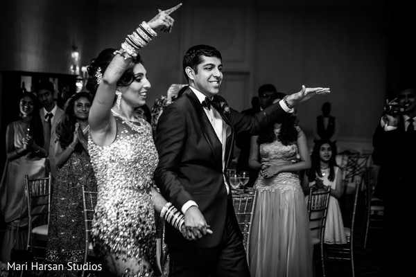 Indian bride and groom entering the wedding reception. in Southhampton, Bermuda Indian Wedding by Mari Harsan Studios