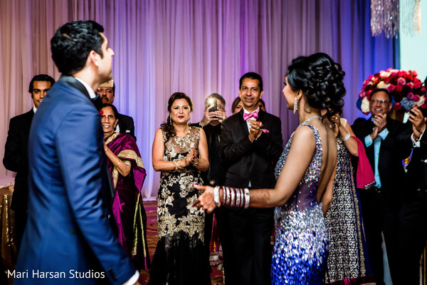 Guests welcoming the happy couple. in Southhampton, Bermuda Indian Wedding by Mari Harsan Studios