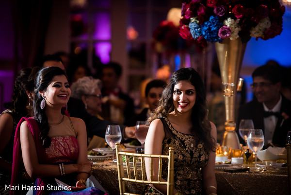 Guests enjoying of the wedding reception. in Southhampton, Bermuda Indian Wedding by Mari Harsan Studios